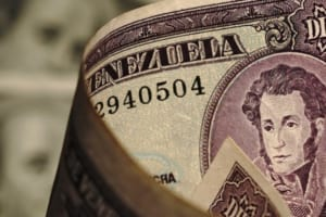 ベネズエラ移民、ビットコインで送金も、問題あり